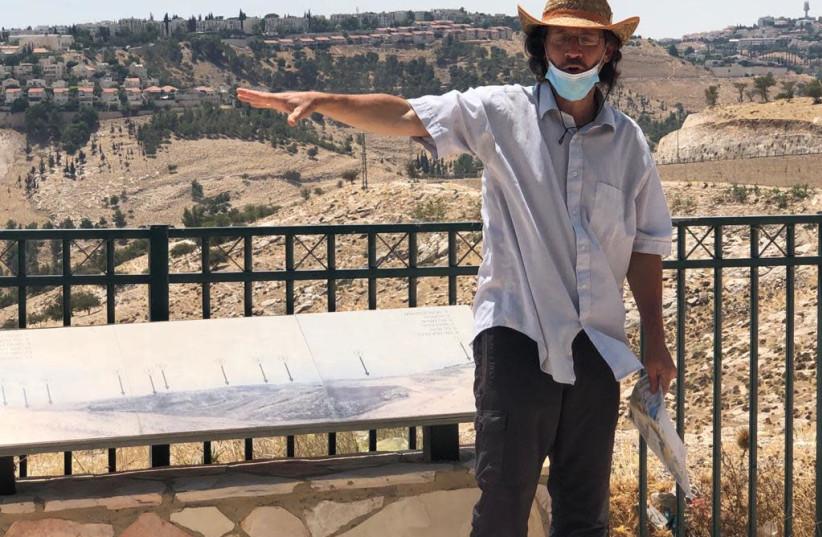 Ir Amim researcher Aviv Tatarsky on the E1 hilltop.  (photo credit: TOVAH LAZAROFF)