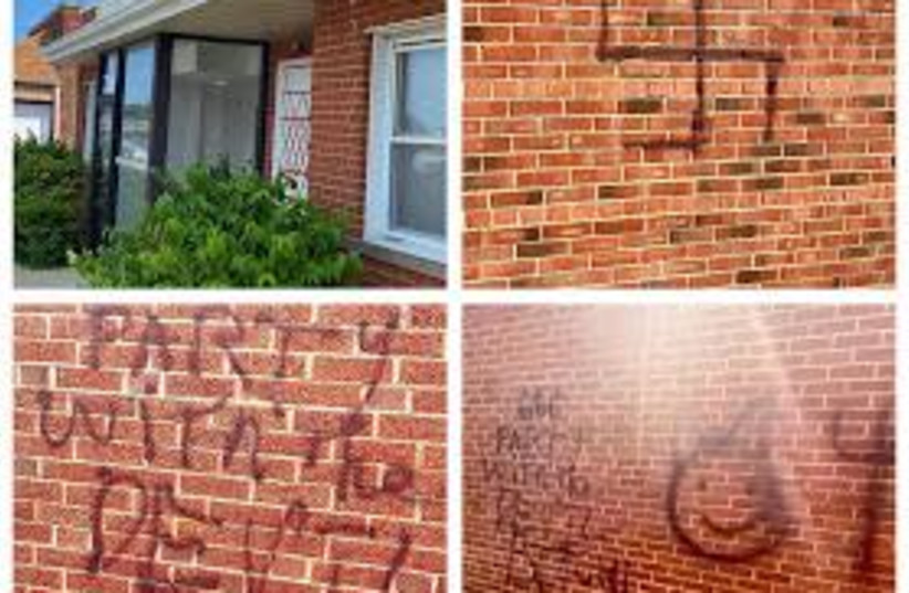 A swastika and other rude and antisemtic phrases spray painted onto buildings, including the Waxman Torah Center in Cleveland, Ohio, July 27, 2020. (photo credit: STOP ANTISEMITISM FACEBOOK PAGE)