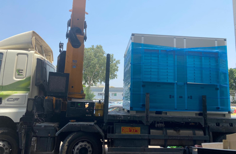 A Watergen generator was donated to Gaza's second largest hospital by Watergen Company and the Arava Institute for Environmental Studies with Palestinian partners, July, 2020. (photo credit: WATERGEN)