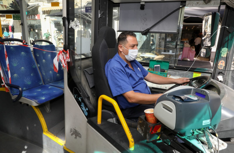 Bus driver works during the coronavirus outbreak, 2020 (photo credit: MARC ISRAEL SELLEM)