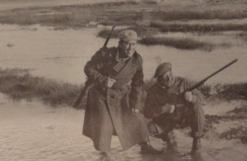 ADAMS STANDS with a senior officer near Kibbutz Ruhama, 1948. (photo credit: Courtesy)