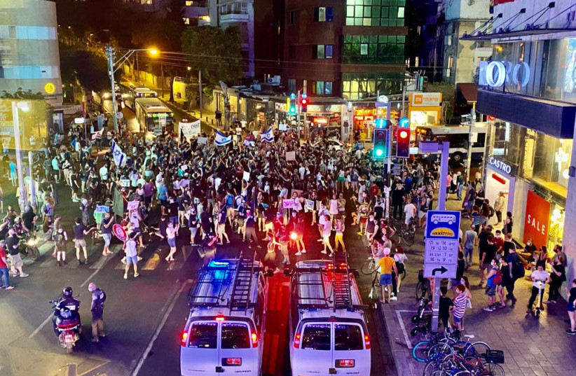 Hundreds of protesters gather in Tel Aviv to protest against police brutality and Amir Ohana, July 28. (photo credit: AVSHALOM SASSONI/ MAARIV)