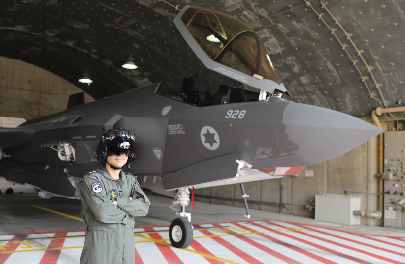 AN IAF pilot poses proudly next to an F-35 (photo credit: MARC ISRAEL SELLEM/THE JERUSALEM POST)