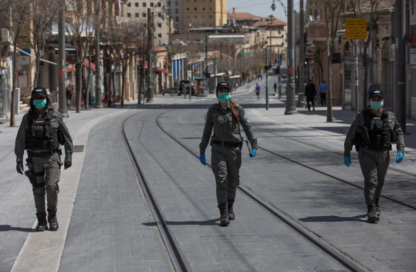 BORDER POLICE patrol a nearly empty city center during a partial lockdown in early April (photo credit: NATI SHOHAT/FLASH90)
