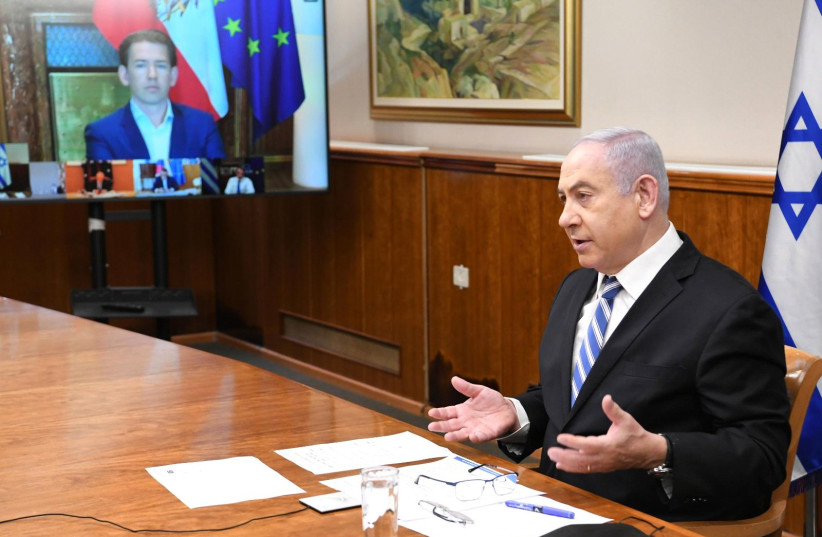 Prime Minister Benjamin Netanyahu consults on coronavirus with world leaders on July 29, 2020 (photo credit: AMOS BEN GERSHOM, GPO)