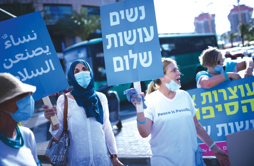 WOMEN FROM the 'Women Wage Peace' movement protest US President Donald Trump's 'Deal of the Century,' in Tel Aviv, last month. (photo credit: TOMER NEUBERG/FLASH90)