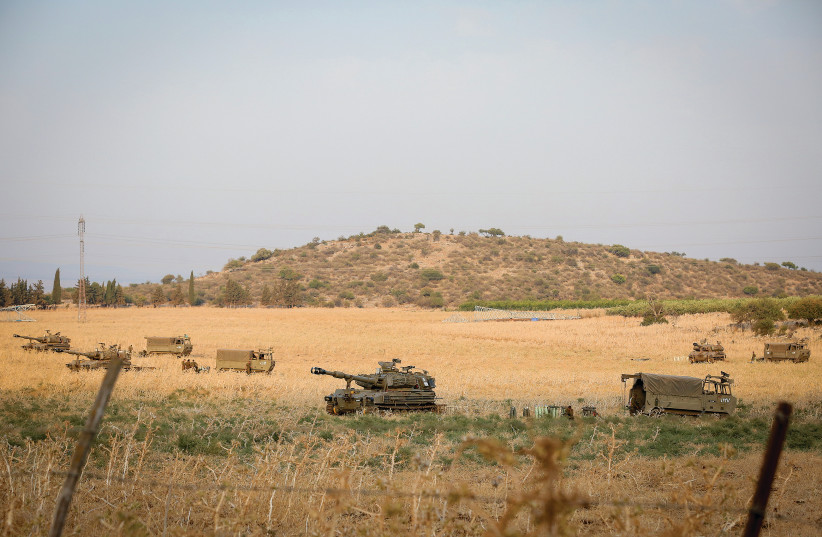 IDF TROOPS are seen stationed near the border between Israel and Lebanon in the Golan Heights, this week. (photo credit: DAVID COHEN/FLASH 90)