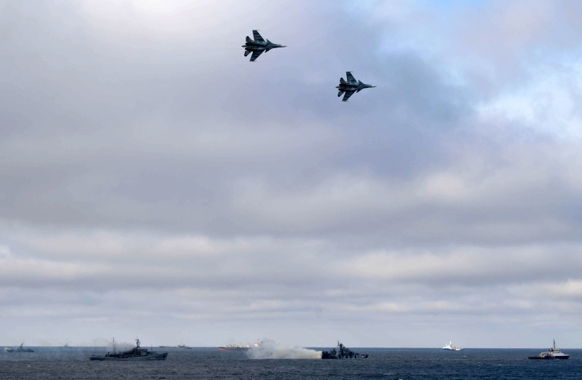 Russian Navy's ships and jet fighters are seen during the joint drills of the Northern and Black Sea fleets, attended by Russian President Vladimir Putin, in the Black Sea, off the coast of Crimea January 9, 2020 (photo credit: SPUTNIK/ALEXEI DRUZHININ/KREMLIN VIA REUTERS)