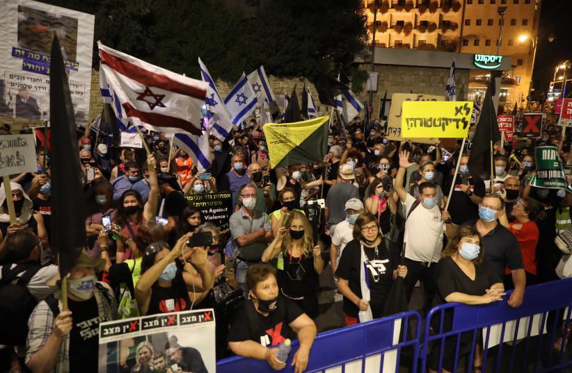 Protesters demonstrate outside of Prime Minister Benjamin Netanyahu's residence in Jerusalem (photo credit: MARC ISRAEL SELLEM)