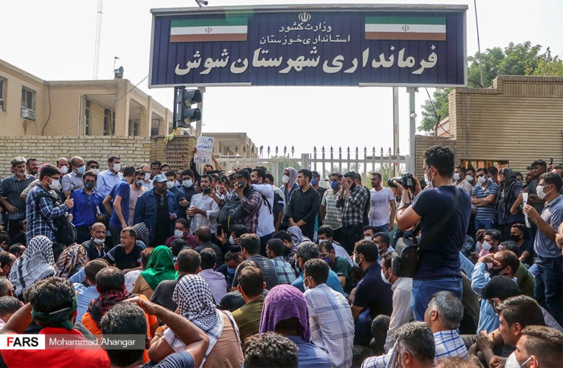 Iranians protest at the Haft Tappeh Sugarcane Industrial Complex, August, 2020 (photo credit: MOHAMMAD AHANGAR/FARS NEWS AGENCY)