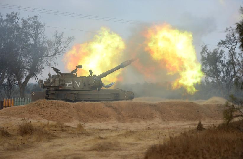 IDF Artillery Corps fires 155 mm M-109 howitzer gun during Operation Protective Edge, Gaza, 2014 (photo credit: IDF SPOKESPERSON'S UNIT)