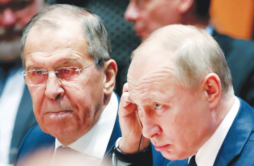 RUSSIAN PRESIDENT Vladimir Putin and Foreign Minister Sergey Lavrov attend the Libya summit in Berlin, Germany, January 2020 (photo credit: HANNIBAL HANSCHKE/REUTERS)