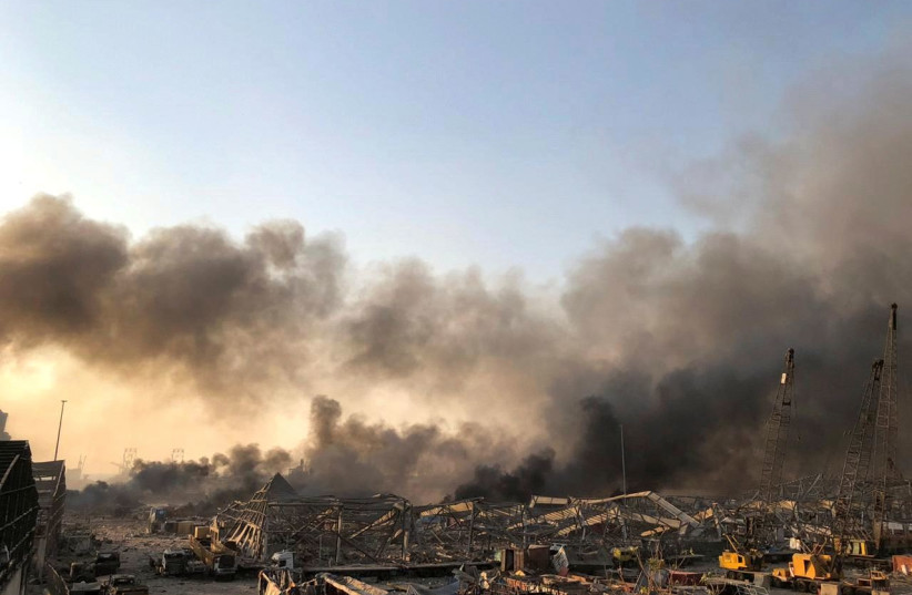 Smoke rises after an explosion was heard in Beirut, Lebanon August 4, 2020 (photo credit: REUTERS/ISSAM ABDALLAH)