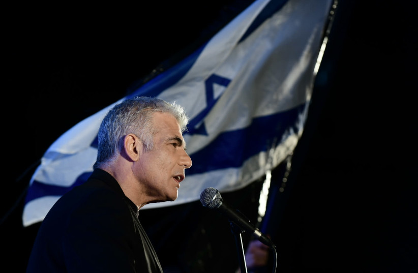 MK Yair Lapid speaks during a protest against Prime Minister Benjamin Netanyahu calling on him to quit, at Rabin Square in Tel Aviv on April 19, 2020 (photo credit: TOMER NEUBERG/FLASH90)