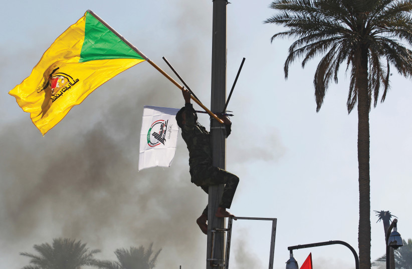 'THERE IS no dispute between Lebanon and Israel over any territory, so why is Iran funding Hezbollah?' (Pictured: Hezbollah flag) (photo credit: REUTERS/KHALID AL MOUSILY)