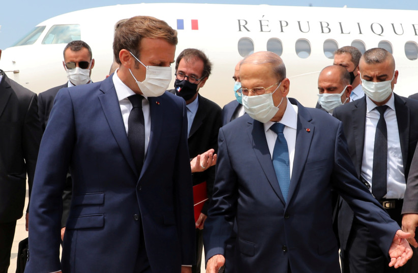 Lebanon's President Michel Aoun welcomes French President Emmanuel Macron upon his arrival at the airport in Beirut, Lebanon August 6, 2020 (photo credit: DALATI NOHRA/HANDOUT VIA REUTERS)