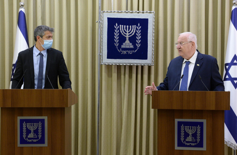 President Reuven Rivlin with Communications Minister Yoaz Hendel , August 11, 2020 (photo credit: MARK NEYMAN/GPO)