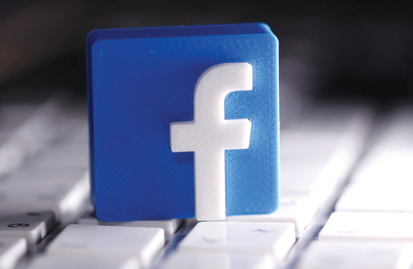 CONTENT THAT promotes the idea that Jews control the banks and the media do not directly attack anyone, and thus do not fall into Facebook's 'hate speech' category. (photo credit: DADO RUVIC/REUTERS)