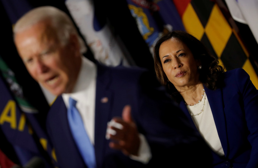 US Democratic vice presidential candidate Senator Kamala Harris listens as presidential candidate and former Vice President Joe Biden speaks at a campaign event, their first joint appearance since Biden named Harris as his running mate, at Alexis Dupont High School in Wilmington, Delaware, U.S., Aug (photo credit: REUTERS/CARLOS BARRIA/FILE PHOTO)