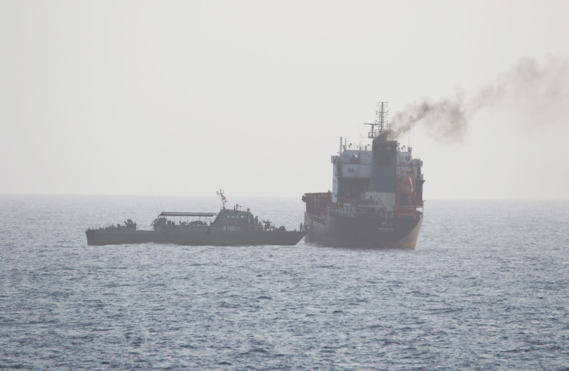 This picture released by the U.S. Navy allegedly shows a ship of the Iranian Navy and members of the Iranian forces boarding civilian tanker WILA en-route to the UAE, in international waters in the Strait of Hormuz, August 12, 2020. Picture taken on August 12, 2020 (photo credit: US NAVY/HANDOUT VIA REUTERS)