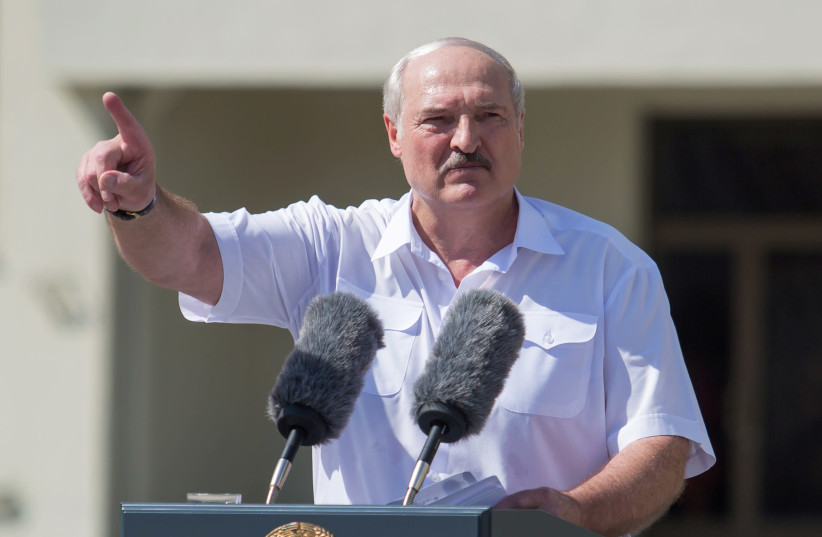 Belarusian President Alexander Lukashenko gestures as he delivers a speech during a rally of his supporters near the Government House in Independence Square in Minsk, Belarus August 16, 2020 (photo credit: REUTERS/STRINGER)
