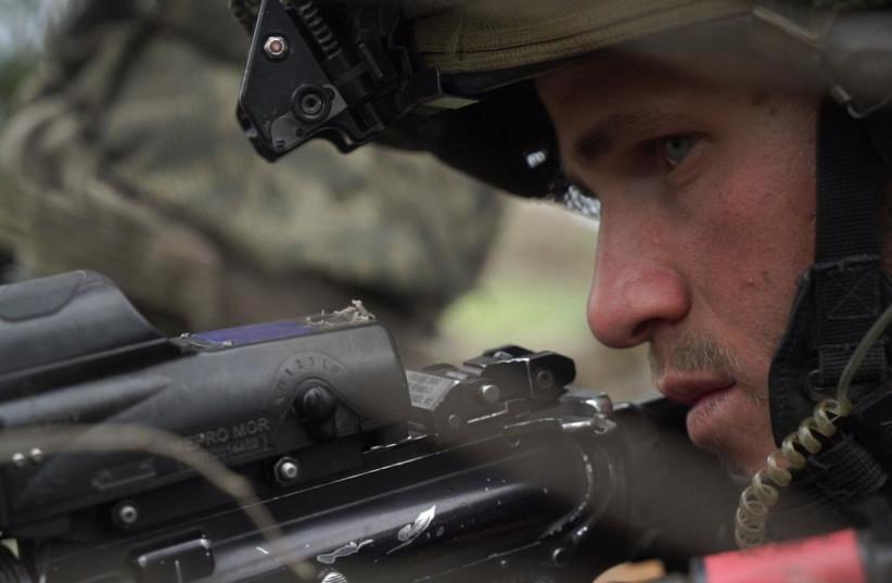 An IDF soldier trains in combat techniques (photo credit: IDF SPOKESPERSON'S UNIT)
