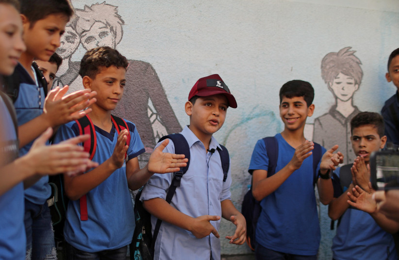 Gaza rapper, 11, strikes chord with rhymes about war and hardship