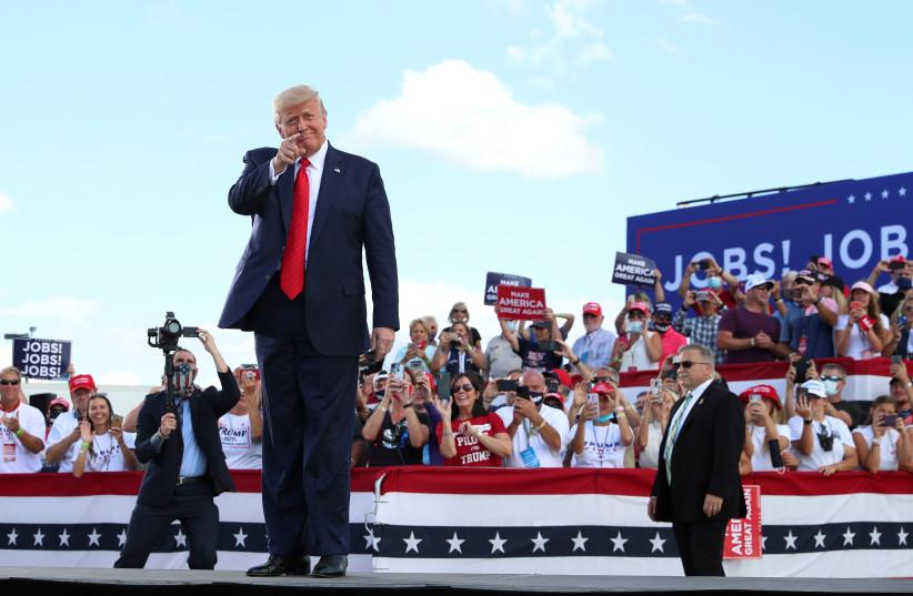 US President Donald Trump delivers remarks at Basler Flight Service in Oshkosh, Wisconsin (photo credit: TOM BRENNER/REUTERS)