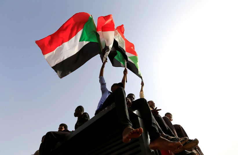 Sudanese protesters shout slogans and wave flags during a rally honouring fallen protesters at the Green Square in Khartoum, Sudan July 18, 2019 (photo credit: REUTERS/ MOHAMED NURELDIN ABDALLAH)