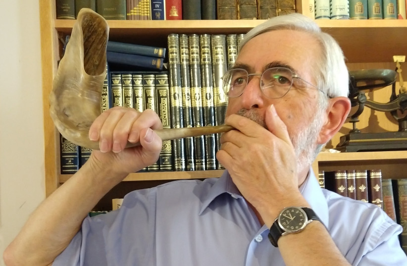 THE WRITER demonstrates how to hold the shofar. (photo credit: DAVID OLIVESTONE)