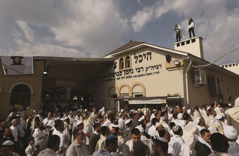 JEWISH PILGRIMS pray at the tomb of Rabbi Nachman of Breslov in Uman during the celebration of Rosh Hashanah in September 2017. (credit: VALENTYN OGIRENKO/REUTERS)