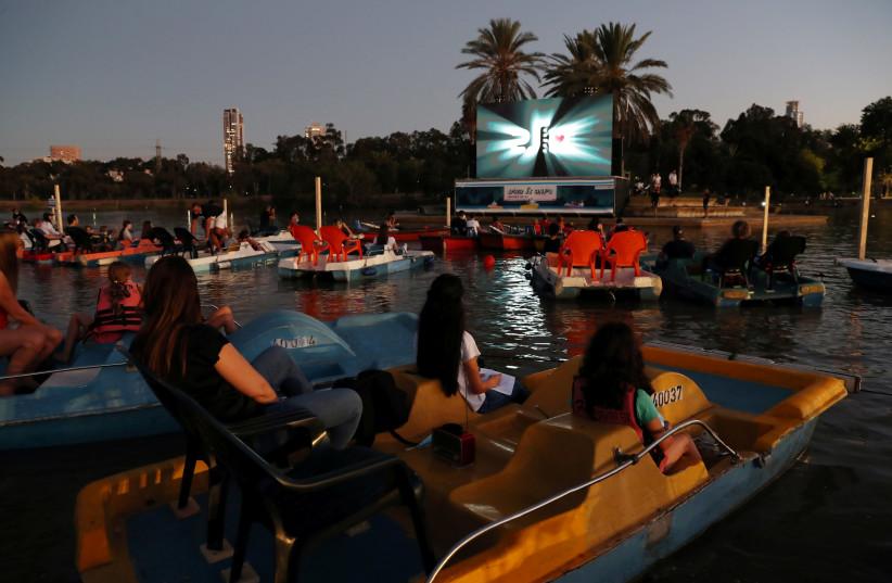 'Sail-in' theatre pops up in Tel Aviv, with indoor flicks off-limits (photo credit: RONEN ZVULUN/REUTERS)