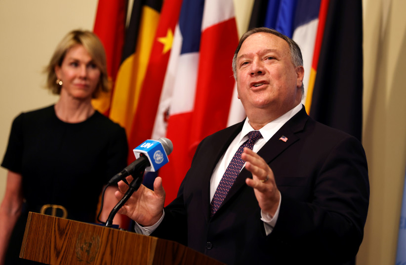U.S. Secretary of State Mike Pompeo speaks to reporters following a meeting with members of the U.N. Security Council about Iran's alleged non-compliance with a nuclear deal and calling for the restoration of sanctions against Iran as U.S. Ambassador to the United Nations Kelly Craft listens at U.N. (photo credit: REUTERS/MIKE SEGAR/POOL)