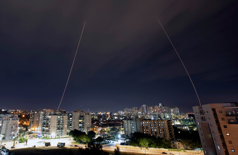 Iron Dome anti-missile system fires interception missiles as rockets are launched from Gaza towards Israel, in the city of Ashkelon, Israel, February 23, 2020 (photo credit: REUTERS/AMIR COHEN)