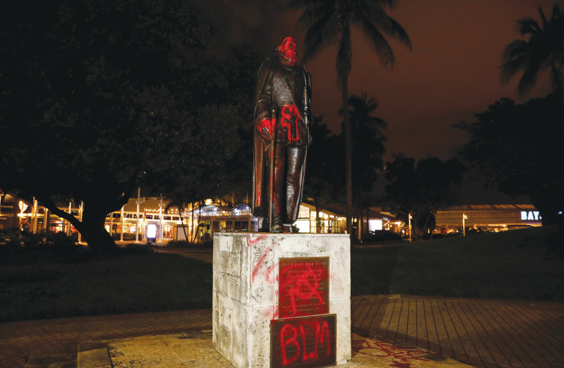 VANDALIZED STATUE of Christopher Columbus is seen in Miami in June.  (photo credit: MARCO BELLO/REUTERS)