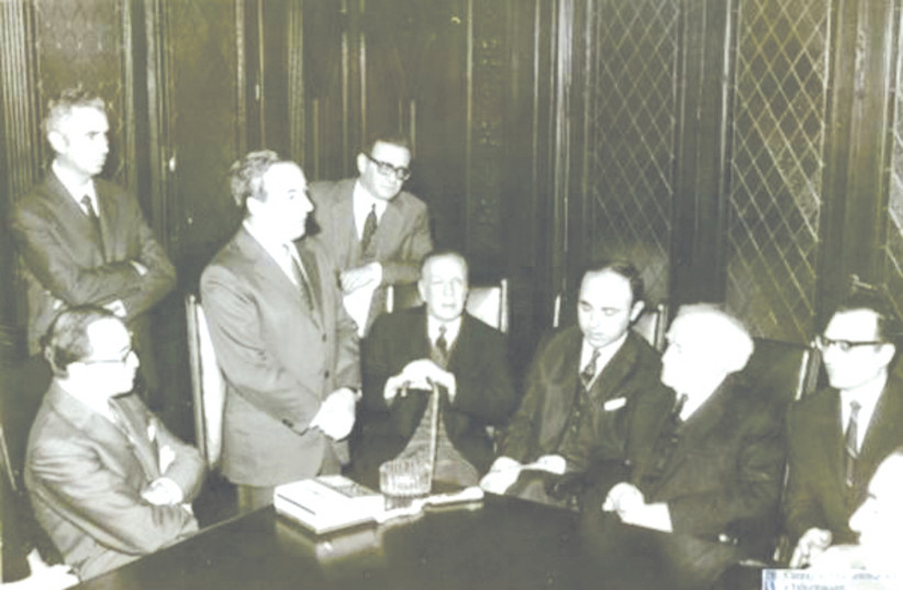 DAVID BEN-GURION meets in Buenos Aires with Baruch Tenembaum and Jorge Luis Borges to his right. (photo credit: MARC TURKOW CENTER/AMIA)