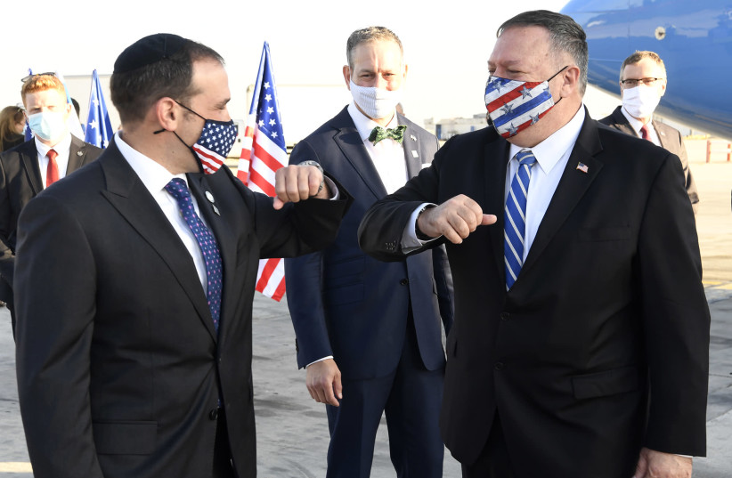 US Secretary of State Mike Pompeo (R) lands in Israel and is greeted by Aryeh Lightstone, senior adviser to US Ambassador to Israel David Friedman, ahead of a visit to several Middle Eastern and Gulf countries, August 24, 2020 (photo credit: MATTY STERN/US EMBASSY JERUSALEM)