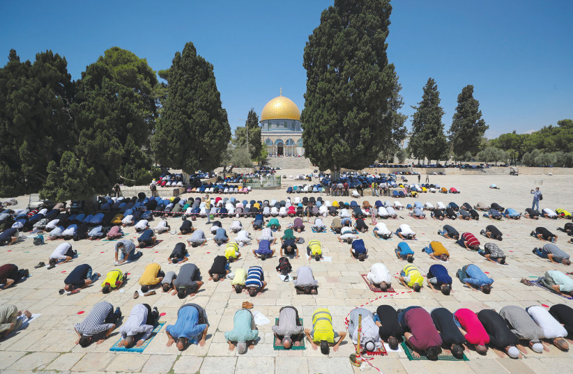 Muslims pray in front of the Dome of the Rock. (photo credit: AMMAR AWAD / REUTERS)