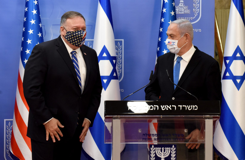 U.S. Secretary of State Mike Pompeo and Israeli Prime Minister Benjamin Netanyahu wear face masks after a joint news conference in Jerusalem, August 24, 2020.  (photo credit: DEBBIE HILL/REUTERS)