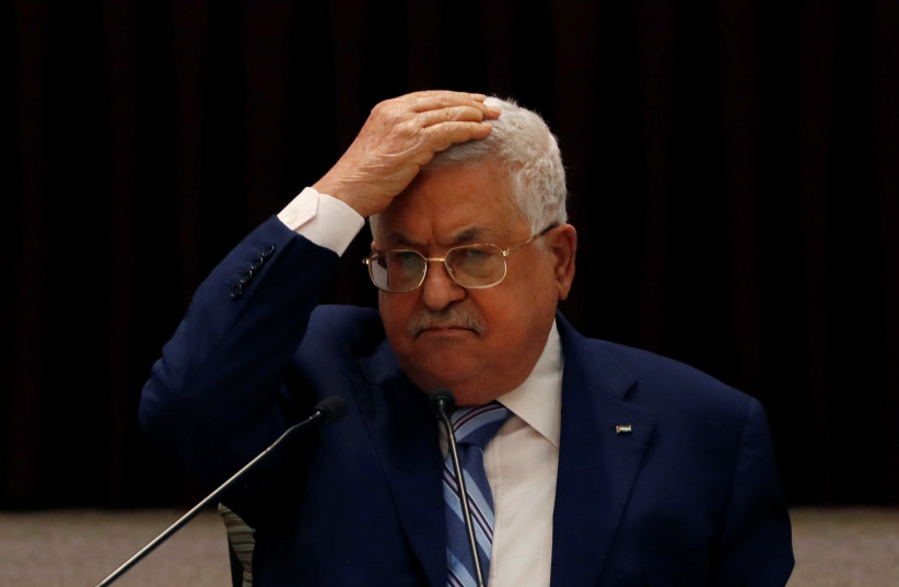 President Mahmoud Abbas gestures during a meeting with the Palestinian leadership to discuss the United Arab Emirates' deal with Israel to normalize relations, in Ramallah in the Israeli-occupied West Bank August 18, 2020 (photo credit: REUTERS/MOHAMAD TOROKMAN/POOL)