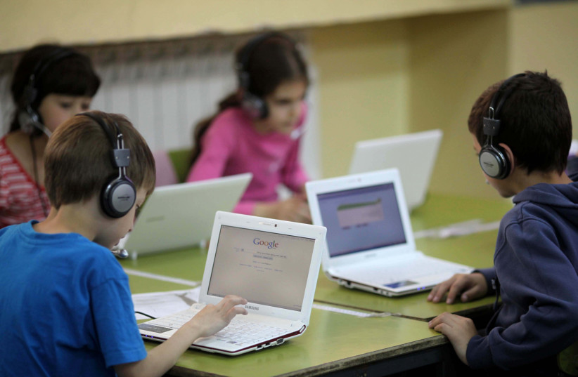 "Israeli children in second grade (7 - 8 years old) using computers in a class room during a lesson at the ""Janusz Korczak"" school  in Jerusalem. May 17, 2011. (photo credit: KOBI GIDEON/FLASH90)"