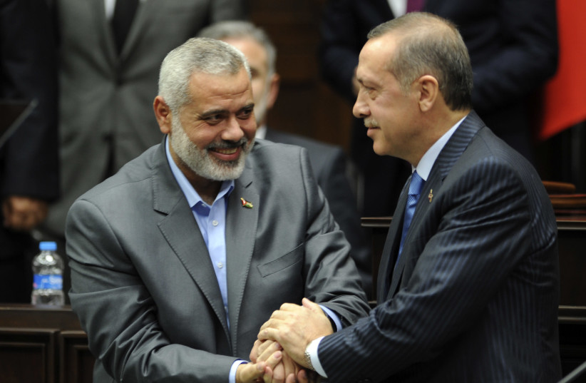 Turkey's Prime Minister Recep Tayyip Erdogan (R) and Hamas' Gaza leader Ismail Haniyeh shake hands during a meeting at the Turkish parliament in Ankara January 3, 2012 (photo credit: REUTERS)