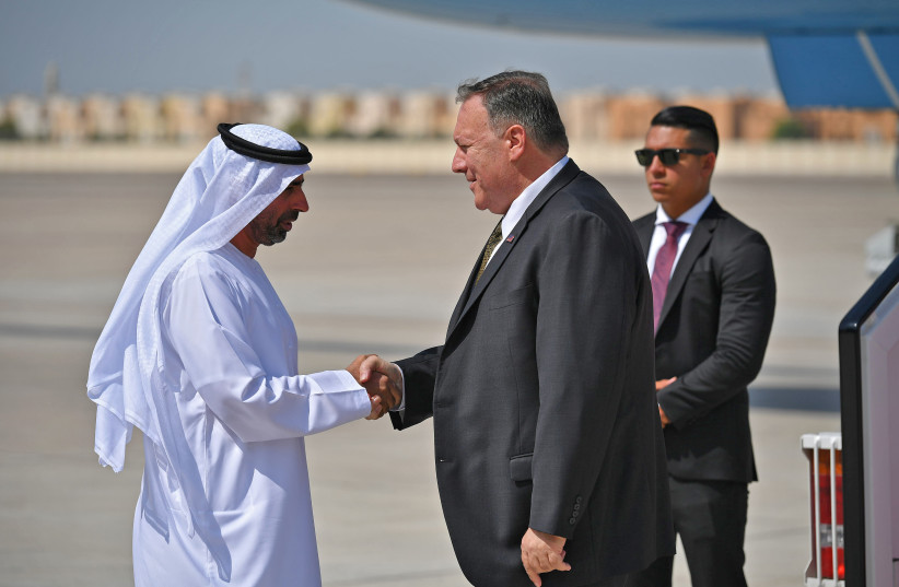 US Secretary of State Mike Pompeo (C) shakes hands with an unidentified UAE official upon his arrival at al-Bateen Air Base in Abu Dhabi, United Arab Emirates September 19, 2019. (photo credit: REUTERS)