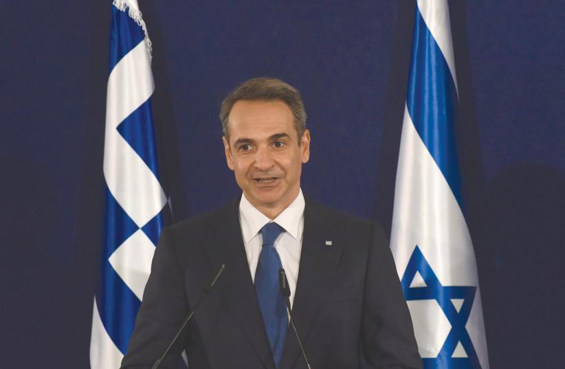GREEK PRIME MINISTER Kyriakos Mitsotakis speaks during a joint press briefing with Prime Minister Benjamin Netanyahu in Jerusalem, June 2020  (photo credit: DEBBIE HILL/REUTERS)