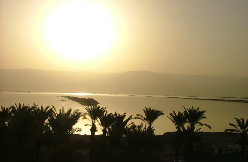 The sun rises over the Dead Sea, Israel (photo credit: Wikimedia Commons)