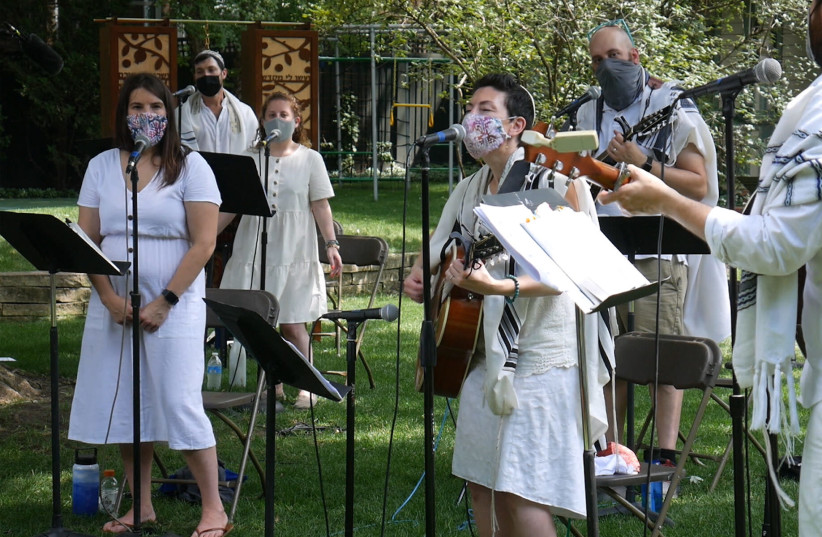 To create a pre-recorded online service, Rabbi Lizzi Heydemann, center, and musicians and singers from Mishkan Chicago recorded the songs and prayers of the High Holidays in August (photo credit: COURTESY OF SEE3 DIGITAL EVENTS)