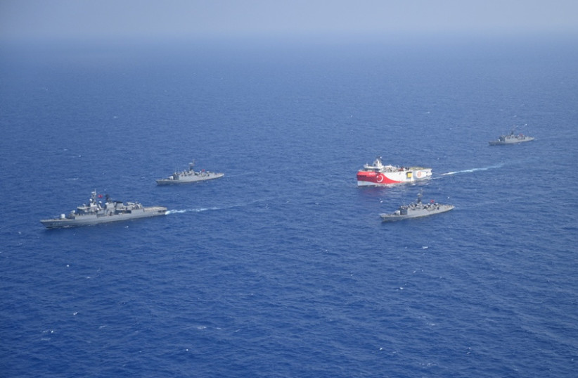 Turkish seismic research vessel Oruc Reis is escorted by Turkish Navy ships as it sets sail in the Mediterranean Sea, off Antalya, Turkey, August 10, 2020. (photo credit: TURKISH DEFENCE MINISTRY/HANDOUT VIA REUTERS)