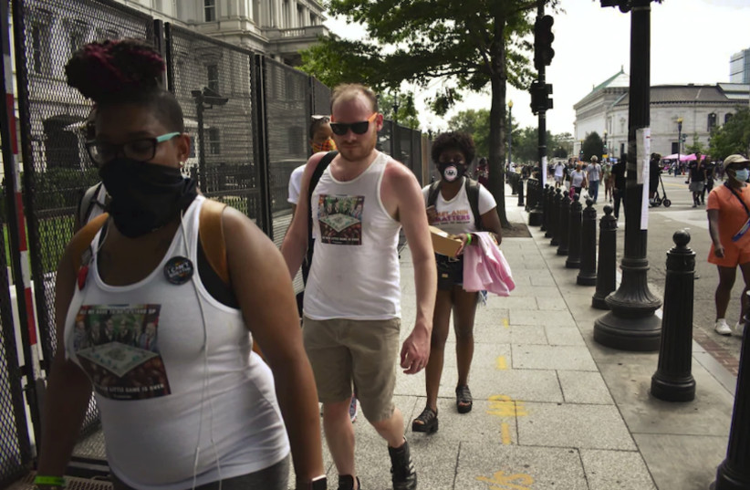 Protestors near the White House at the 'March on Washington 2020' wearing shirts bearing an antisemitic mural. Washington DC, USA, August 28, 2020 (photo credit: COURTESY JENNIE TAER / THE SARAH CARTER SHOW)