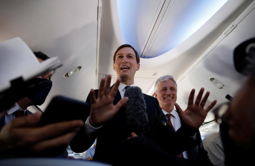 Jared Kushner beside Robert O'Brien on the first Israeli flight to UAE (photo credit: REUTERS/NIR ELIAS)
