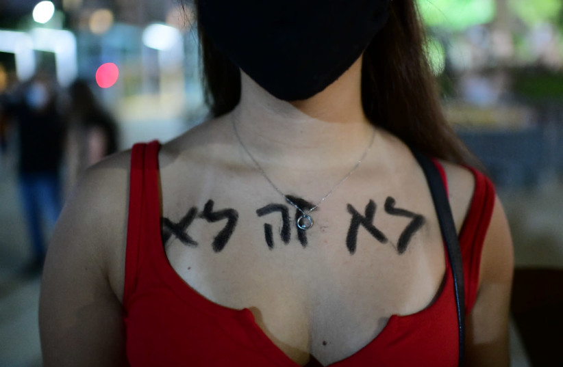 Israelis take part in a demonstration in support of the 16 year old victim of a gang rape in Eilat a few days ago, in Tel Aviv. August 22, 2020 (photo credit: TOMER NEUBERG/FLASH90)